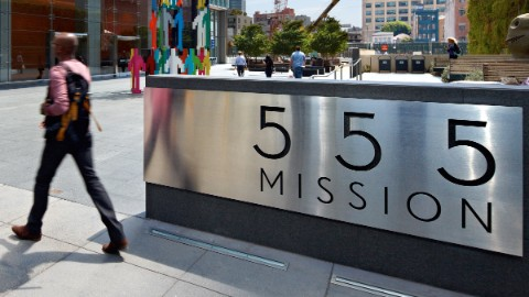 "Plaque in front of the San Francisco building at 555 Mission Street stating ""555 Mission""."